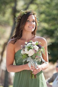 Moss green bridesmaid dress paired with a bouquet and flower halo