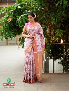 The pink Parampara pattu saree with the flow of blossoms in the body with the delicate golden zari work in the border and pallu gives the saree a traditional touch of our heritage which when paired with a high-neck sleeveless blouse makes it trendy. #grandsaree #silksaree #puresilk #saree #traditionalsaree #sareedesigns #sareestyles #weddingsaree #puresilksaree #sareedraping #sareelooks #draping#paramparasilksaree #paramparasarees #handloomsaree #bridalsaree #sareeembroidery #pattusaree