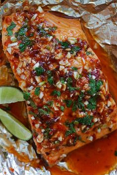 Chili Lime Salmon - moist, tender and delicious foil-wrapped salmon marinated with chili-garlic sauce and lime juice. Easy weeknight recipe that takes 30 mins Baked Salmon Recipes, Fish Recipes, Seafood Recipes, Vegaterian Recipes, Snapper Recipes, Recipes Dinner, Asian Recipes, Fish Dishes, Seafood Dishes