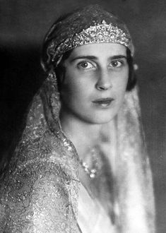 Princess Olga of Yugoslavia, nee Greece, wearing what may well be one of Cartier's rare blackened steel tiaras. It's strikingly similar to one of the blackened steel tiaras on show at the British Museum last century in their Cartier Exhibition