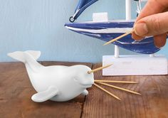 "A <a href=""http://www.fredandfriends.com/what%27s-new/polar-picks/5186690.html"" target=""_blank"">narwhal</a> with a replenishing toothpick horn."
