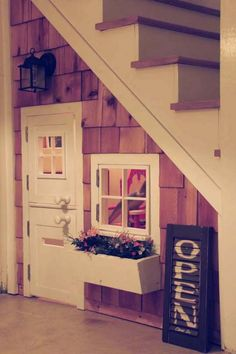 A play house under the stairs. If I ever live in a house with stairs. Oh, and this play house would be for me. Under Stairs Playhouse, Space Under Stairs, Indoor Playhouse, Inside Playhouse, Closet Playhouse, Childs Playhouse, Toddler Playhouse, Indoor Forts, Playhouse Ideas