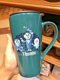 Disney Parks Haunted Mansion Hitchhiking Ghosts Three Thumbs Up Travel To Go Mug  | eBay $38.55 Disney Coffee Mugs, Disney Mugs, Hitchhiking Ghosts, Going On A Trip, Halloween Items, Fun Cup, I Love Coffee, Haunted Mansion, Disneyland Paris