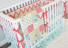 Coral, Gold and Aqua Crib Bedding and Patchwork Blanket from @gigglesix - love the on-trend color combos and patterns! #PNpartner