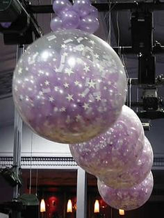 """balloon bomb - 36"""" latex exploding balloon, air-filled & holds ninety 5"""" latex & flutter confetti inside. the bomb can be used to effect a balloon drop or balloon release, covering the dance floor or other surface with brightly colored balloons"""