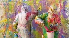 two-artists-in-paint-splatter-protective-coveralls-splashing-around-multi-colored-paint-and-creating-abstract-mural_ejjjc1fhx__M0000.jpg (640×360)