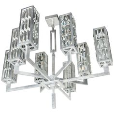 Modernist 8 Arm Cut Crystal Chandelier in the Manner of Frank Lloyd Wright | From a unique collection of antique and modern chandeliers and pendants  at https://www.1stdibs.com/furniture/lighting/chandeliers-pendant-lights/