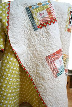 Quilt with modern log cabin blocks - love the dotted back in contrast to the mostly white front