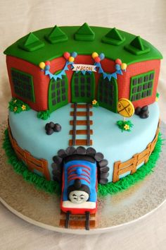 Thomas the train round house cake, tidmouth sheds w/ name banner. This is a fun cake. Any Thomas fan would love to have it. This reminds me of the cake I made for Joshua's birthday Thomas Birthday Cakes, Thomas Cakes, Thomas The Train Cakes, 3rd Birthday, Cupcakes, Cupcake Cakes, Torta Angel, Rodjendanske Torte, House Cake