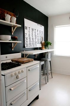 """Pinner says:It never occured to me to have a shelf along the wall on my sunporch with bar stools instead of a dining table. Levi can use the end for his drawing area. GENIUS 
