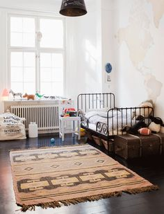 map wall, moroccan rug, vintage textiles. great room.