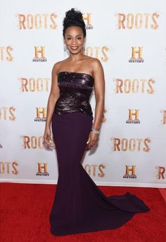 Anika Noni Rose wore a bold plum Georges Chakra Fall 2014 Ready-to-Wear gown to the Roots Premiere