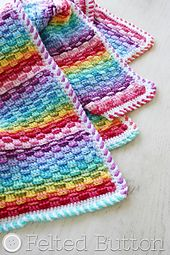 Take a simple textured stitch pattern that looks woven, add some colorful stripes and you've got The Basket of Rainbows blanket! It can be worked up in any dimensions you wish and with any number of colors.