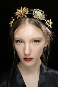 Dolce & Gabbana Fall 2015 Beauty: A model shows off the red lipstick and elegant hair accessories of fall.