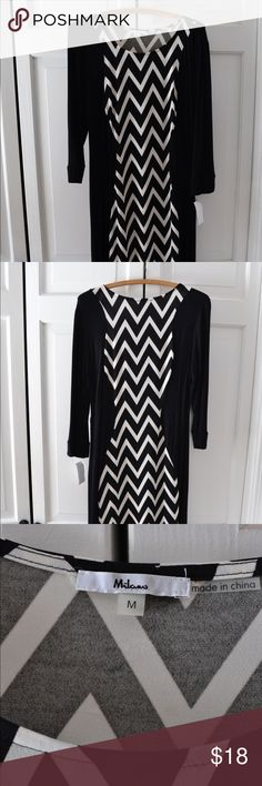 """New Milano 3/4 Sleeve Chevron Dress New with tags. Medium black and white Milano midi 3/4 sleeve dress, with slimming chevron design. 44 inches top to bottom. I'm 5'10"""" and this dress falls below my knees. Very soft and stretchy fabric, that you can look and feel good in. Milano Dresses Midi"""