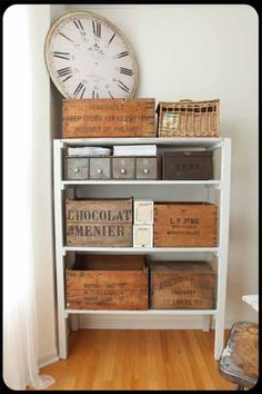antique storage: would love to find old boxes like that! And that clock! (an OLD one, not a cheapy reproduction). I'm snooty that way, though I do love my oval clock I bought at Pier 1...on sale.