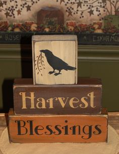 - HANDMADE~ I have painted this Harvest Blessings primitive wood block set in nice… HANDMADE~ I have painted this Harvest Blessings primitive wood block set in nice fall colors. I have added a primitive crow on the top block. They have been painted with b Fall Wood Crafts, 2x4 Crafts, Wood Block Crafts, Autumn Crafts, Wood Blocks, Glass Blocks, Holiday Crafts, Halloween Crafts To Sell, Fall Halloween