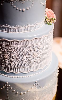 This Walt Disney World wedding cake is a blend of vintage and modern with its lace appliques
