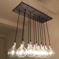 The Chic Urban Chandelier is a handmade hanging light fixture from Urban Chandy. A chandelier with a decidedly industrial feel, this piece was created by designer and company founder Cassidy Brush and is made from gray-stained reclaimed wood, silver hardware and large globe-style bulbs. Each design features 12 bulbs and can be mounted flush against the ceiling or suspended!