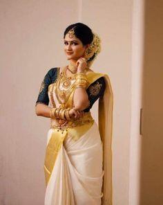 Sooo Pretty ***Like the Blouse style? Get it custom made for you at TheBlouseSto. Kerala Hindu Bride, South Indian Bride Saree, Kerala Wedding Saree, Indian Bridal Sarees, Indian Bridal Outfits, Indian Bridal Fashion, Indian Bridal Wear, Indian Beauty Saree, Wedding Outfits
