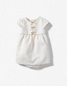 Sweet little dress, love the crisscross lacing up the front.  On older girls (preschool-young grade school, like mine!) would be sweet with pantaloons underneath