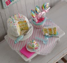 "Miniature Birthday Confetti Cake With Candles, A Slice Of Cake, A Cupcake, A Pot Of Lollipops,  And A Cute ""Happy Birthday"" Wall Hanging"