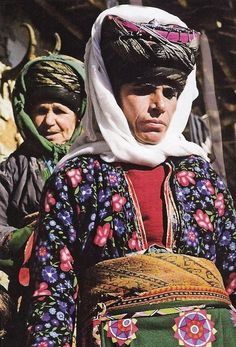Elderly Kurdish women in traditional daily costumes, including impressive headgear.  From the Adiyaman province, rural fashion, ca. 1980.