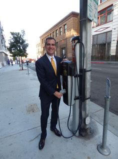 DOWNTOWN LOS ANGELES - Downtown found itself on the forefront of the effort to combat gas guzzling last week, when a parking spot became home to Los Angeles' first public electric vehicle charging station.
