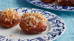 Cardamom and cinnamon scent these coconut fried-dough confections from Oman. They're great for breakfast or dessert or make a delectable snack any time of day.