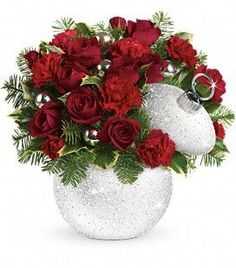 Shimmering Snow Bouquet. Dazzle and delight with red roses and carnations presented in our fabulous iridescent and silver-glitter-covered Shimmering Snow ornament jar.