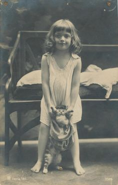 vintage photo, girl and cat.