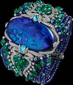 CARTIER. Bracelet - platinum, one 85.42-carat oval-shaped cabochon-cut black opal, sapphire beads, long emerald beads, Paraiba tourmalines, brilliant-cut diamonds. #Cartier #ÉtourdissantCartier #2015 #HauteJoaillerie #HighJewellery #FineJewelry #Opal #Emerald #Sapphire #ParaibaTourmaline #Diamond