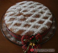 Vasilopita - Traditional Greek cake that is cut at midnight New Year's eve. Greek Sweets, Greek Desserts, Greek Recipes, Xmas Food, Christmas Sweets, Christmas Cooking, Holiday Treats, Holiday Recipes, Kitchens