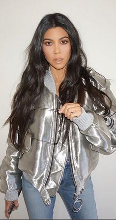 Who made  Kourtney Kardashian's silver bomber jacket and blue jeans?