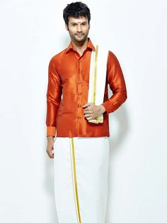 Admirable orange color raw silk shirt paired with white color cotton dhoti and angavastram. Item Code : SCU12002-7 http://www.bharatplaza.com/new-arrivals/south-indian-mens-wear.html