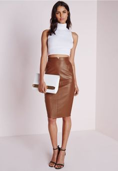You'll be up in flames in this faux real sexy midi skirt, featuring a split up the back, pockets and a cut out detail on the front. We love faux leather skirts and this one in tan fits the bill. Team with a white plunge body and strappy bar...