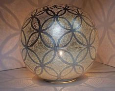 The Ball Circles Lamp Silver is handmade in silver plated brass. When using a transparent bulb, a stunning shadow pattern is projected. Moroccan Lamp, Moroccan Design, Brass Floor Lamp, Brass Table Lamps, Handmade Mirrors, Silver Shop, Vintage Lighting, Kugel, Messing