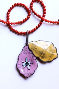 love the Bee Locket - not so sure about the red beads, tho