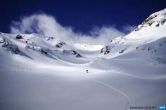 BULGARIA, BANSKO : A skiier enjoys the slops of the Pirin Mountains on March 3, 2015. Bulgaria receives more than 13% of its GDP from low-cost tourism in its three major ski resorts and seaside...