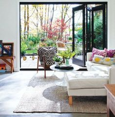 cottage modern  danish chair upholstered in la fiorentina  sisal rug  mid century modern