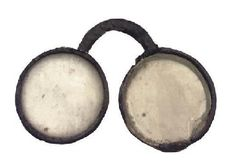 "1600s ""A pair of rare English leather nose/bow spectacles,  the right lens frame detached from the bridge and damaged."" - Christie's"