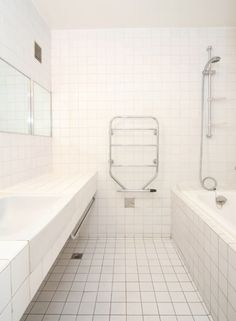Barbican, London — The Modern House Estate Agents: Architect-Designed Property For Sale in London and the UK Washroom Tiles, Hall Tiles, Heated Towel Rail, Barbican, White Tiles, White Bathroom, Interior Architecture, Property For Sale, Bathtub