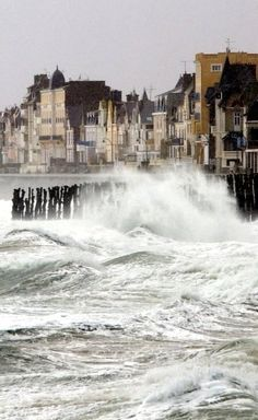 Waves break onto the docks of Saint-Malo, Brittany, France. This city was absolutely beautiful
