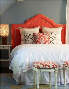 love the headboard shape and the two stools at the end of the bed from merideth heron