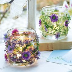 Amazing DIY idea... could fasten silk flowers with hot glue to a mason jar! Remember to fill the jar with Candle Impressions Flameless Candles or the glue could melt.