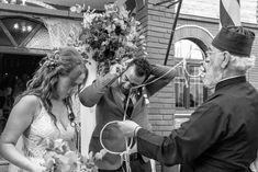 Priest trying to help groom unravel the crowns