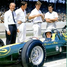 Jim Clark, Colin Chapman [in tie] and team-members on Carburetion Day, 1963. Interestingly, this may have been [along with the Gurney #93] the last car[s] at Indy to actually HAVE carburetors!