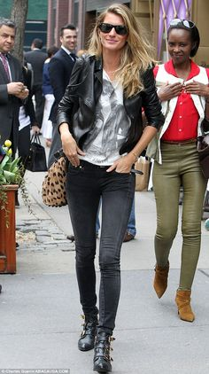 Biker chic: Gisele Bundchen channelled 1970s New York by wearing a leather jacket and, big boots and dark shades in the city today