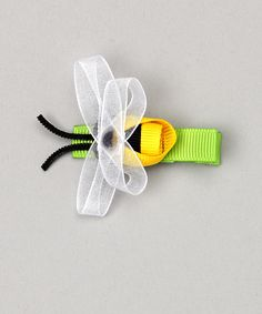 bee hair bow! I need to check this out because my granddaughter starts Hutchison in August!!