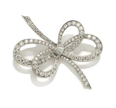A diamond bow brooch, Van Cleef & Arpels  signed VC, no. 20022; estimated total diamond weight: 2.50 carats; mounted in platinum; length